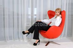 Photo: Woman, leader, who sits in a red chair Recycled Plastic Adirondack Chairs, Cheap Adirondack Chairs, Composite Adirondack Chairs, Wooden Dining Room Chairs, Mid Century Modern Armchair, Patterned Armchair, Egg Chair, Bean Bag Chair, Furniture