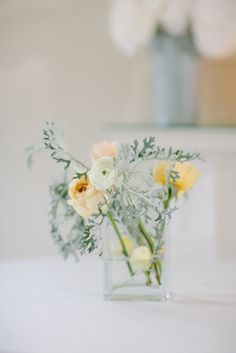 wedding floral centerpieces http://www.weddingchicks.com/2013/09/11/peach-and-gray-wedding/