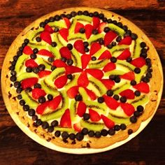Chocolate Chip Cookie Dessert Pizza with strawberries, kiwi and blueberries.