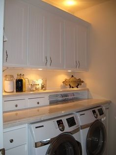Like this with a single combo front loader washer/dryer and a wood counter.