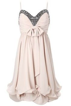 Cream colored ruffled dress with a bedazzled top