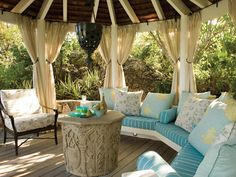 An octagonal cabana makes a cozy spot for cold drinks and watching sunsets. #pillows #comfy #relaxing