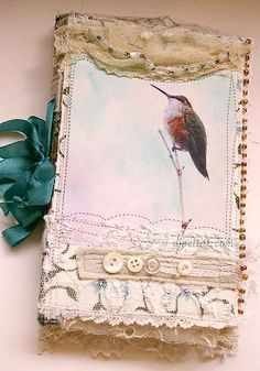 Beautiful hand made book, with antique lace, ribbons and buttons. The front piece is an antique post card.