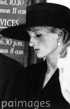 A somber-looking Princess Diana, wearing a wide-brimmed hat and veil leaves the funeral of close friend Adrian Ward-Jackson, former governor of the Royal Ballet, died of AIDS. 29 Aug 1991