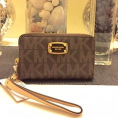 Michael kors tech wrist wallet Brand new with tags 100% authentic brown large Michael Kors Bags Wallets