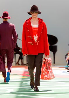 Vintage book print t-shirt worn under a double cashmere duffle coat in orange red with the travel satchel