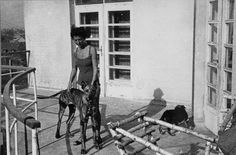 Majola, the mistress of commandant Amon Goeth, stands on the balcony of his villa in the Plaszow concentration camp with his dog Ralf.