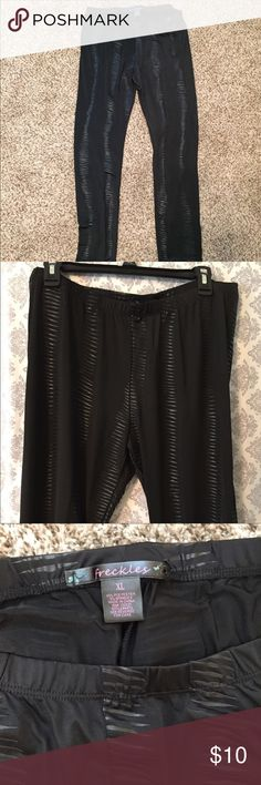 Freckles brand XL leggings. These look really cute under a short jean shirt or under a long tunic. They have almost a zebra like texture. Only worn one time and now they are too big. 95% Polyester/5% Spandex Pants Leggings