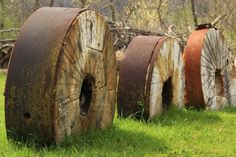 Millstone Fence by Mark Tibbits on Capture Wisconsin // Three retired mill stones in a row