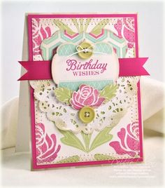 PTI products by Debbie Olson.  Stamps: Happy Day, Rosie Posie  Cardstock: Rustic White, Raspberry Fizz. Ink: Hibiscus Burst, Raspberry Fizz, Spring Moss, Aqua Mist, Chamomile Distress Cube.  Dies: Happy Day die, Layers Mat Stack 4, Parisian Lace Doily, Rosie Posie. Extras: Raspberry Fizz Grosgrain, Chartreuse Vintage Buttons, Prisma Glitter, cotton crochet thread, sewing machine.