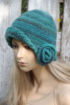 This is a handmade, crochet hat for women. It is crocheted by hand, by me. It suits any outfit style has very soft hand feel. Colour: shadows turquoise/green  Measurements: Head circumference: 55-57cm[21.5-23] 50%wool 50% acrylic Hand wash in cold water with detergent or shampoo and lay flat until dry.  This one is in stock and ready to shipping.