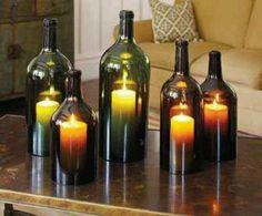 Wine candles - 1) Fill up a sink with ice water w/enough to submerge bottle.  2) Take your yarn and wrap it around the bottle (where you want to cut) about 5 or 6 times.  3) Remove yarn and soak in polish remover Place back on bottle.  4) Hold the neck of the bottle, light the yarn. Turn the bottle slowly so that it burns evenly.  5) When flame stops, dip the entire bottle into the ice water.  6) Sand edges.