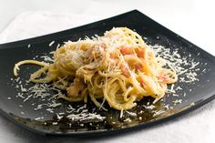 Photo about Spagetti carbonara on a black plate. Image of drink, green, cooking - 2891925 Spagetti Carbonara, Cooking Tips, Cooking Recipes, Italian Pasta Dishes, Your Recipe, Pasta Recipes, Spaghetti, Food And Drink, Dinner