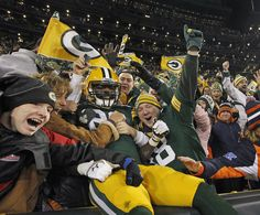 Green Bay Packers tight end Brandon Bostick does a Lambeau Leap after scoring on a 1-yard touchdown catch. - Image credit: Rick Wood Packers 55, Bears 14 - JSOnline