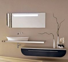Luxury bathroom suite ideas such as fittings, taps, tiles, cabinets, sink bowls, showers, tubs and mats from Brighton UK