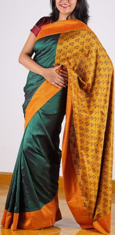 The usual combination of bottle green and mustard is given a mesmerizing makeover because of the mustard stripes on the border and the red block prints on the yellow/orange/green checked , extended pallu and voila, this beautiful Kanchipuram piece turns to another dimension, making it suitable for both weddings as well as cocktail parties. SHOP AT www.ubikaa.com