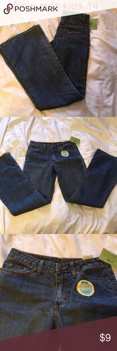 New kids girls jeans 14 adjustable waist New with tags  riders medium wash adjustable waist jeans, flair waist 27 but can be taken in with elastic button straps inside. Riders Bottoms Jeans