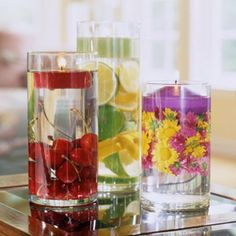fill a large vase with brightly colored fruit or flowers and top with a candle