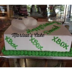 Xbox controller birthday cake. Visit us Facebook.com/marissa'scake or www.marissa'scake.com