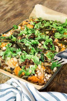 Fall nachos with sweet potato, caramelized onions and arugula, recipe by @waitingonmartha
