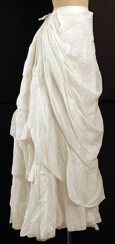 Petticoat, 1880s, probably American, made of cotton and linen. Petticoats, during this time, even had the bustle of fabric in the back to add extra fullness in addition to the butt pads. The draping of this petticoat would allow the dress to be puffed and full in the back.