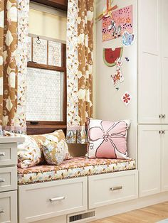 Window-Seat Storage  -- A niche tucked between the corner desk and media-storage cabinet offers a cozy seating area without taking up additional floor space.  -- Beneath the upholstered window seat, quiet-close drawers (which keep little fingers safe) store extra blankets.  -- Magnetic paint and magnets on the side of the media cabinet display kids' art.