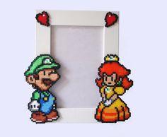 Luigi & Daisy - Paper Mario Picture Frame . White Frame with Luigi and Daisy. Horizontal or Vertical. €17.00, via Etsy.