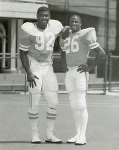 Tennessee teammates Reggie White, left, and Willie Gault stand ...