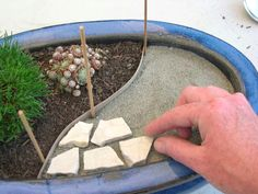 Tells exactly how to make a patio for fairy garden or mini train village