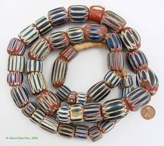 Other Names: Chevron, Star, Rosetta  Type of bead: chevron  Made in: Venice  Collected From: Africa  Approximate Age: 1400s-1500s  Overall Condition: excellent  Damage, Repair: old pitting  Strand length: 39 inches. 45 beads      FABULOUS Strand of old Venetian 7 layer chevrons traded in Africa in the 1400s and 1500s.