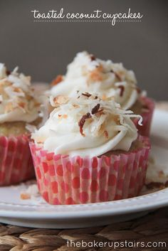 Toasted Coconut Cupcakes from The Baker Upstairs. These cupcakes are like a beach vacation in a cupcake wrapper! Moist and delicious, with the perfect subtle hint of coconut... yum! http://www.thebakerupstairs.com