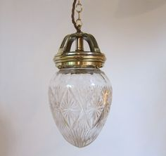 English pendant light in polished brass complemented by period cut glass shade. c 1900 www.antiquelightingcompany.com