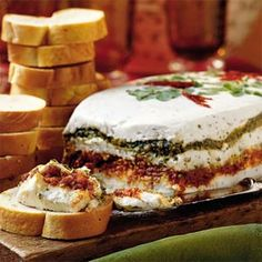 Layer pesto, sun-dried tomato, and a mixture of goat cheese and cream cheese for an impressive appetizer with Mediterranean flavors. Serve with French bread slices or crackers.