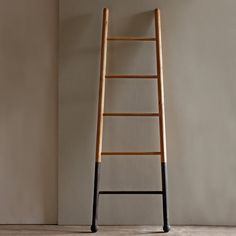 """Based on orchard ladders used in picking apples and pears. Our """" Bloak"""" Ladders are made of solid white oak and dipped in an oxide to blacken the bottom. We use them to display blankets, towels or scarves . Great at the beach house for suits and towels or in the country as a drying rack for lavender or herbs. Made in USA."""