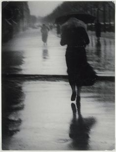 Photograph: Brassai, Passers-by in the rain, 1935.