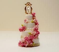 1:12 Scale Dollhouse Miniature Royal Pink Wedding Cake. $35.00, via Etsy.