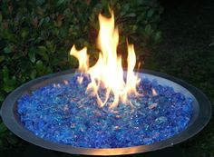 You can use colored glass rock for your fire pit!