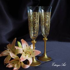 "Set of two hand painted toasting flutes ""Golden lace"". These rich and beautiful glasses with painted lace are in gold, decorated with a hint of glitter. Lace design brings a sense of sophistication and style. They are unique and perfect present for weddings, anniversaries, birthdays,"