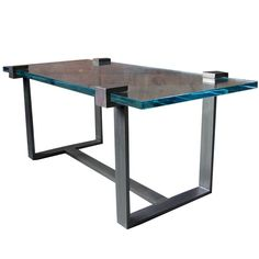 "An original RT Facts design. Clasp low/coffee table. this table has 1"" Low iron glass, and a bronzed cold rolled steel finish.  As seen on the cover of June 2010 Architectural Digest Magazine. Size is custom to order, price will vary.  20""H x 40""l x 22""d"
