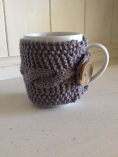 Hand knitted coffee cozy on Etsy, $12.00