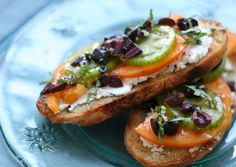 open faced. toasted tomato. basil. and goat cheese. sandwich.