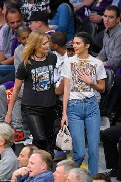 Kendall Jenner wearing Manolo Blahnik Tayler Pumps in Nude, Jacquie Aiche Shaker Diamond Choker, Givenchy Lucrezia Micro Bag in Blush and Los Angles Lakers World Champs Back to Back T-Shirt