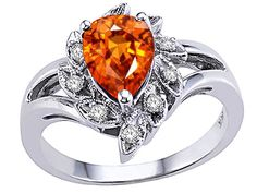 Orange Engagement Ring ... Not my style totally, but I love the idea of an orange stone instead of the traditional diamond!