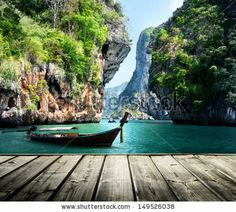 long boat and rocks on railay beach in Krabi, Thailand - stock photo