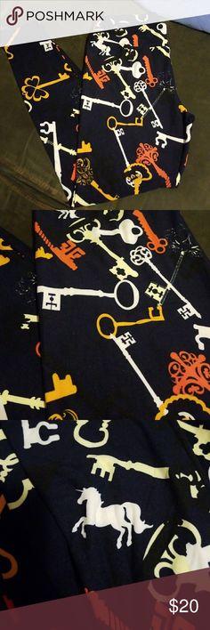 Lularoe leggings Lularoe leggings TC. TC fits size 12 to 24. excellent condition. NWOT. navy background with keys. LuLaRoe Pants Leggings