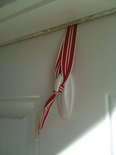 wreath holder--more flexible that the metal over the door thing.