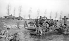 A truck-mounted 40-mm Bofors anti-aircraft gun of UK 15th (Scottish) Division crossing the Rhine River near Xanten, Germany, 24 Mar 1945 (Imperial War Museum)