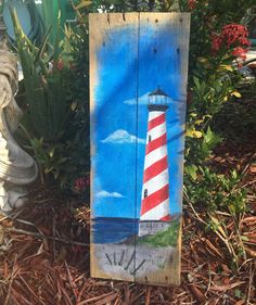 Lighthouse Painting Lighthouse Decor Lighthouse Wall Art Nautical Wall Art Nautical Decor Pallet Art Beach Home Decor Ocean Art Coastal This beautiful rustic lighthouse on reclaimed pallet wood would be the perfect addition to your beach house or any rustic nautical home decor. It is hand painted using acrylic paints then sealed with a clear varnish. The measurements of the sign are: 10x 20. A protective sealer has been applied for long lasting durability but intended for interior use…