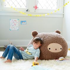 Shop Small Bijou Kitty Bear Bean Bag Chair. Little cubs can relax and take a comfy seat thanks to our bear bean bag chair. It's extra soft and features brown faux fur, a charming face design and decorative ears. Designed just for us by Bijou Kitty.