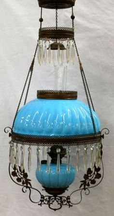 A blue Fostoria [glass, hanging parlor lamp], melon rib [domed] shade and font, [colorless prisms, ornate frame]. Victorian Lighting, Victorian Lamps, Antique Lighting, Antique Oil Lamps, Vintage Lamps, Fostoria Glass, Ohio, Kerosene Lamp, Tiffany Lamps